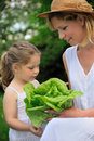 Young mother and daughter with lettuce Royalty Free Stock Photography
