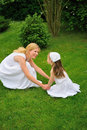 Young mother and daughter playing in meadow Royalty Free Stock Image