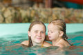 Young mother with daughter swim in aqua park Stock Image