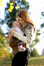 Young mother with her baby in a carrier Stock Photography