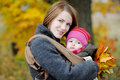 Young mother and her baby in a carrier Stock Image