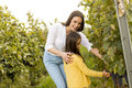 Young mother and her cute girl in autumn vineyard Royalty Free Stock Photo