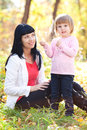 Young mother and her daughter on the autumn forest Stock Photography