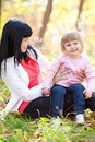 Young mother and her daughter on the autumn forest Royalty Free Stock Photography