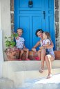 Young mother and her daughter sitting on doorstep of old house in emporio village santorini greece this image has attached release Stock Images