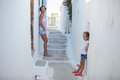 Young mother with her little daughter in a greek village on the cyclades islands this image has attached release Stock Images