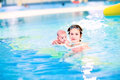 Young mother and her newborn baby swimming beautiful enjoying in pool Royalty Free Stock Images