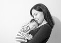 Young mother holding her newborn child. Mom nursing baby. Royalty Free Stock Photo