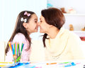Young mother with little daughter sitting together at home Stock Photography