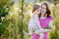 Young mother and a little girl in a meadow Royalty Free Stock Photography