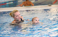 Young mother and little son in a swimming pool Stock Images