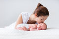 Young mother and newborn baby in white bedroom Royalty Free Stock Photo