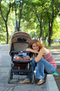 Young mother with perambulator Royalty Free Stock Images
