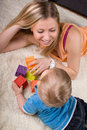 Young mother playing with baby boy Royalty Free Stock Image