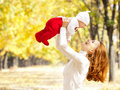 Young mother playing with daughter in autumn park Royalty Free Stock Image