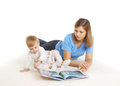 Young mother reading book with her little daughter Royalty Free Stock Photo