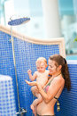 Young mother showing shower to her baby Stock Photography