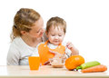 Young mother spoon feeding her baby boy Stock Images