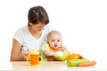 Young mother spoon feeding her baby girl Royalty Free Stock Photo