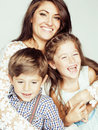 Young mother with two children on white, happy smiling family inside isolated close up Royalty Free Stock Photo
