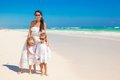 Young mother and two her cute kids at exotic beach on sunny day this image has attached release Stock Image