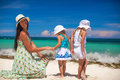 Young mother and two her fashion kids at exotic beach on sunny day this image has attached release Stock Photo