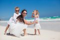 Young mother and two her fashion kids at exotic beach on sunny day this image has attached release Royalty Free Stock Photography