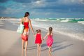 Young mother and two her fashion kids at exotic beach on sunny day this image has attached release Royalty Free Stock Photos