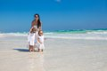 Young mother and two her fashion kids having fun at exotic beach on sunny day this image has attached release Royalty Free Stock Photography