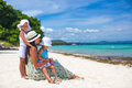 Young mother and two her kids at exotic beach on fashion sunny day Stock Images