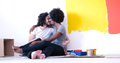 Young multiethnic couple relaxing after painting