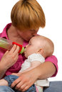 Young Mum bottlefeeding baby Stock Photo