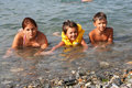 Young mum and children in water Royalty Free Stock Photo