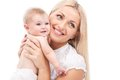 Young mum hugging small baby. beautiful blond holding baby and smiling Royalty Free Stock Photo