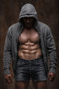 Young muscular man with open jacket revealing muscular chest and abs Royalty Free Stock Photo