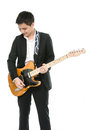Young musician is playing guitar Stock Photography