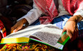 A young muslim boy reading the holy quran Royalty Free Stock Photos