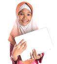 Young muslim girl with laptop ix asian over white background Stock Images
