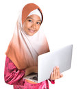 Young muslim girl with laptop viii asian over white background Royalty Free Stock Photo