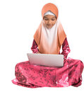 Young muslim girl sitting with laptop ii asian on a floor over white background Royalty Free Stock Photography