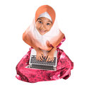 Young muslim girl sitting with laptop iii asian on a floor over white background Stock Photo