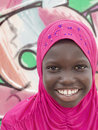 Young muslim girl wearing a pink headscarf ten years old Stock Images