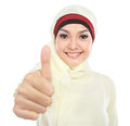 Young muslim woman in head scarf showing thumb up isolated over white background Stock Photos