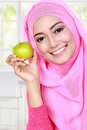 Young muslim woman holding an apple Royalty Free Stock Photo
