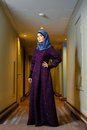 Young Muslim woman in trendy Islamic clothing, standing in the corridor of the hotel Royalty Free Stock Photo