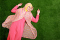 Young muslim woman wearing hijab lying on grass portrait of Stock Images
