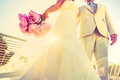 Young newlywed with bouquet at sunset backlight - Wedding couple Royalty Free Stock Photo