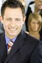 Young handsome succesful businessman smiling Royalty Free Stock Photo