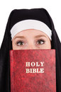 Young nun with bible isolated Stock Photo