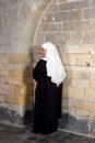 Young nun sister or waiting against the walls of a th century church Royalty Free Stock Photography